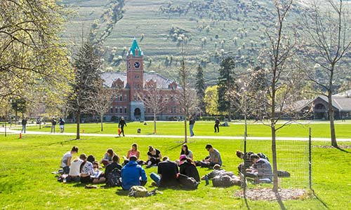 University of Montana School of Environmental Studies students meet on the lawn.